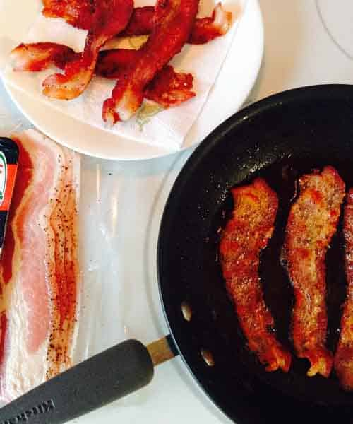 Cooking Bacon on a Griddle of Frying Pan