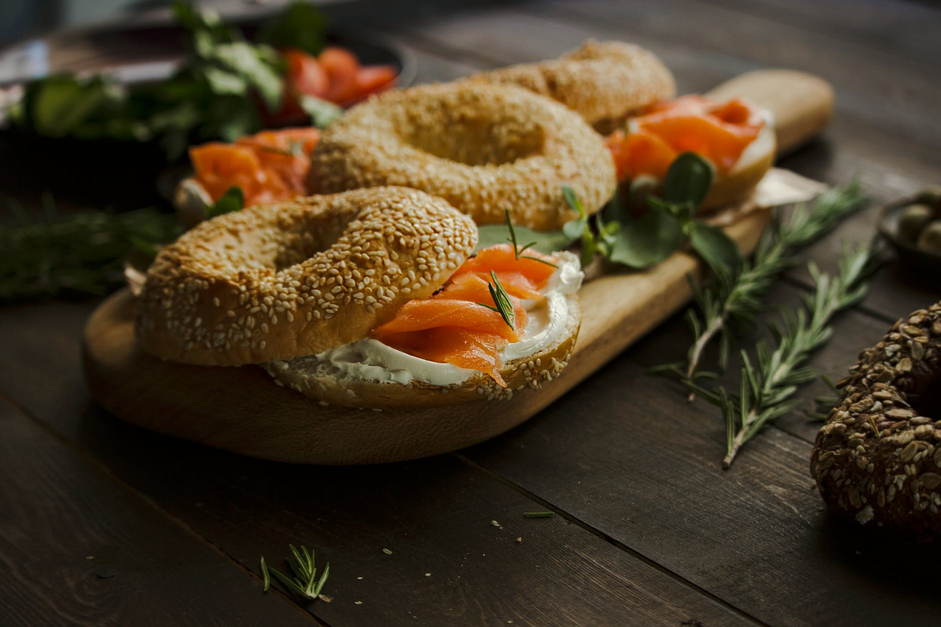 salmon bagel on wooden plank