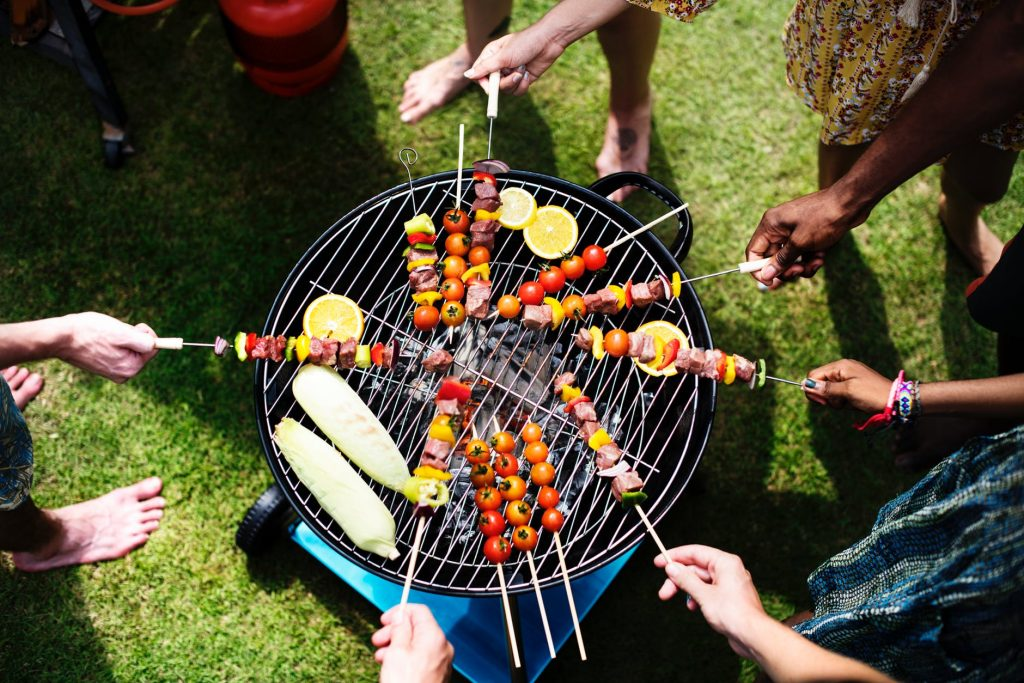 Group of people having a barbecue party