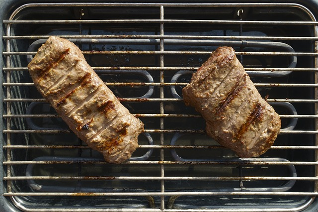 two piece of meat in an electric smoker